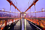 The Brooklyn Bridge, 1595.5 feet long and completed in 1883, is a National Historic Landmark that connects Manhattan and Brooklyn by spanning the East River.