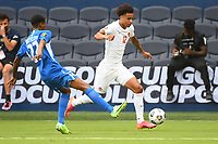 KANSASCITY, KS - JULY 11: Tajon Buchanan #12 of Canada with the ball during a game between Canada and Martinique at Children's Mercy Park on July 11, 2021 in KansasCity, Kansas.