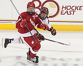 Mark Zengerle (Wisconsin - 9), Michael Matheson (BC - 5) - The Boston College Eagles defeated the visiting University of Wisconsin Badgers 9-2 on Friday, October 18, 2013, at Kelley Rink in Conte Forum in Chestnut Hill, Massachusetts.