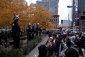 """New York, New York<br /> November 15, 2011<br /> <br /> After the police clear Zuccotti Park many of the evicted """"Occupy Wall Street"""" protesters, reconvened in Foley Square and march to Juan Pablo Duarte Square at Canal and 6th Ave.<br /> <br /> The protesters return at noon to Zuccotti Park to wait a court order to reenter the park. Small scuffles break out between the police and the protesters resulting in a few arrests."""