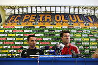 Wednesday 28 August 2013<br /> Pictured L-R: Leon Britton and manager Michael Laudrup during a press conference at Petrolul Ploiesti Stadium. <br /> Re: Swansea City FC arrive to Romania for a press conference and training session, a day before their UEFA Europa League, play off round, 2nd leg, against Petrolul Ploiesti in Romania.