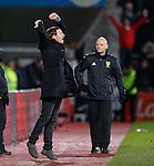 Ian Cathro celebrates the third goal for Hearts