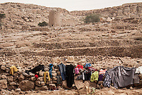 Thursday 16 July, 2015: Clothes drying under the sun of displaced from the heavy fighting and bombarments in Sa'dah governorate and Haradh bordertown are seen in a temporary settlement in the outskirts of Khamer city in the Amran province of Yemen. (Photo/Narciso Contreras)