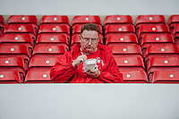 NOTTINGHAM, ENGLAND - JULY 25:  A forest fan eats chips prior to the pre season friendly match between Nottingham Forest and Swansea City at The City Ground on July 25, 2015 in Nottingham, England.  (Photo by Aled Llywelyn / Athena Pictures )