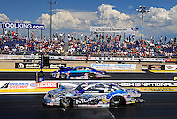 Jul. 24, 2011; Morrison, CO, USA: NHRA pro stock driver Allen Johnson (near lane) races alongside Kurt Johnson during the Mile High Nationals at Bandimere Speedway. Mandatory Credit: Mark J. Rebilas-