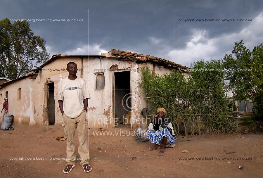 Rwanda, land of the thousand hills, Nyanza, people infront of hut