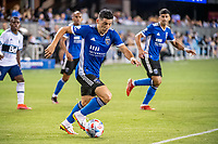 SAN JOSE, CA - AUGUST 13: Cristian Espinoza #10 of the San Jose Earthquakes dribbles the ball during a game between San Jose Earthquakes and Vancouver Whitecaps at PayPal Park on August 13, 2021 in San Jose, California.