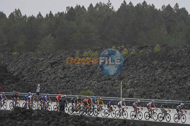 The peloton on the slopes of Mount Etna during Stage 3 of the 103rd edition of the Giro d'Italia 2020 running 150km from Enna to Etna (Linguaglossa-Piano Provenzana), Sicily, Italy. 5th October 2020.  <br /> Picture: LaPresse/Fabio Ferrari | Cyclefile<br /> <br /> All photos usage must carry mandatory copyright credit (© Cyclefile | LaPresse/Fabio Ferrari)