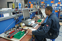 Working on a conveyor component sorting system.  Apprentice engineering students at Kingston College..