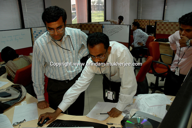 Young Indian people at work in Infosys, Bangalore. Infosys is the largest software company in the country and the head office is in Bangalore, Karnataka, India. Arindam Mukherjee