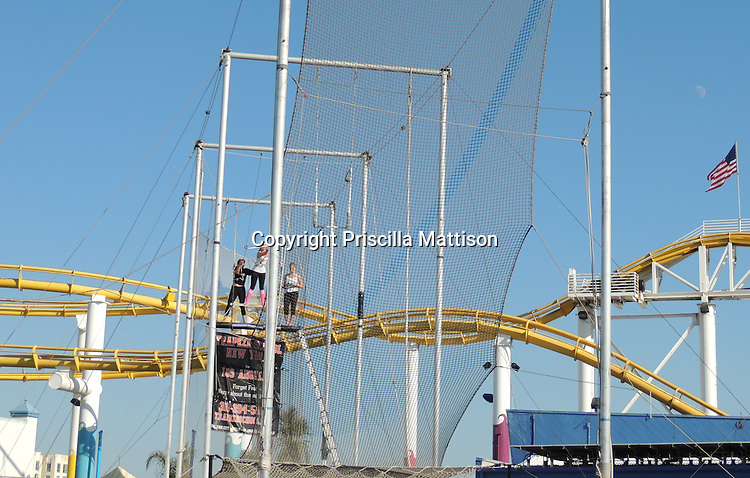 Santa Monica, California - September 23, 2012:  A woman prepares to swing from a trapeze.