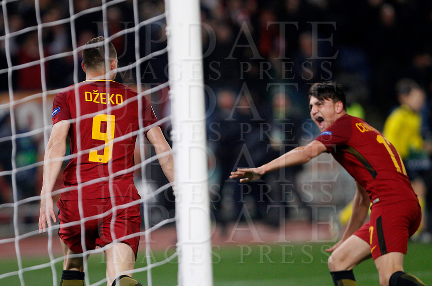 Roma s Edin Dzeko, left, celebrates with his teammate Cengiz Under after scoring the winning goal during the Uefa Champions League round of 16 second leg soccer match between Roma and Shakhtar Donetsk at Rome's Olympic stadium, March 13, 2018. Roma won. 1-0 to join the quarter finals.<br /> UPDATE IMAGES PRESS/Riccardo De Luca