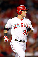 Josh Hamilton #32 of the Los Angeles Angels runs to first base against the Detroit Tigers at Angel Stadium on April 19, 2013 in Anaheim, California. (Larry Goren/Four Seam Images)