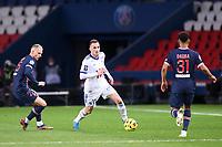 24th December 2020; Paris, France; French League 1 football, Paris St Germain versus Strasbourg;   MITCHEL BAKKER PSG challenges DIMITRI LIENARD STRA