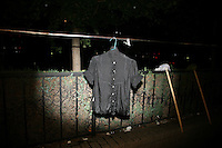 CHINA. Beijing. A shirt hung out in the street to dry. 2008