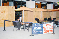 Businesses a block from the White House were boarded up in preparation for anticipated street violence on the night of Election Day in the Foggy Bottom area of Washington, D.C., on Tue., Nov. 3, 2020. Demonstrators in nearby Black Lives Matter Plaza remained peaceful.