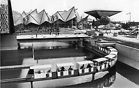 1967 FILE PHOTO - ARCHIVES -<br /> <br /> Workmen were bustling around Expo site today; getting everything in readiness for official opening this afternoon and streams of ordinary visitors expected to pour through gates tomorrow. In view above; miniral makes test run out from under Ontario pavilion and over Regatta Lake; part of Ile Notre-Dame; island built in past four years. Canadian pavilion at right is largest single exhibit.<br /> <br /> 1967<br /> <br /> PHOTO : Boris Spremo - Toronto Star Archives - AQP