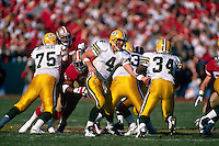 SAN FRANCISCO, CA: Quarterback Brett Favre of the Green Bay Packers hands the ball off during the NFC playoff game against the San Francisco 49ers at Candlestick Park in San Francisco, California on January 6, 1996. (Photo by Brad Mangin)
