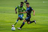 SAN JOSE, CA - OCTOBER 18: Cristian Espinoza #10 of the San Jose Earthquakes passes Yeimar Gomez Andrade #28 of the Seattle Sounders during a game between Seattle Sounders FC and San Jose Earthquakes at Earthquakes Stadium on October 18, 2020 in San Jose, California.