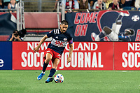 FOXBOROUGH, MA - JULY 7: Carles Gil #22 of New England Revolution collects a pass during a game between Toronto FC and New England Revolution at Gillette Stadium on July 7, 2021 in Foxborough, Massachusetts.