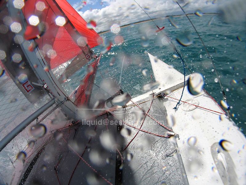Onboard with Rob and Pete Greenhalgh during a training sesson before the Formula 18 World Championship 2007, Yeppoon in Australia..The Formula 18 class, with its F18 abbreviation, is one of the success stories in the sport catamaran scene. It was started in the early 1990s and quickly grew to a full sized ISAF recognised class with big racing fleets all over the globe. Before the turn of the century, the F18 class was attracting up to 150 boats and crews to their world championships. Since then a limit has been placed on attendance (max 150) and therefore qualifier rounds are held in several areas to decide who may go to the world championships and who may not..Currently the F18 class is serviced by 11 professional boatbuilders who all have designed and built their own F18 boat. This is possible because the F18 class is a Formula class. This means that any boat that adheres to a certain limited set of general design specifications may participate in all F18 races. This has led to a score of homebuilders and professional builders to design their own F18 boats and racing them in this class.