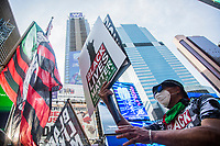 """NEW YORK, NY - JULY 26: Hundreds of protesters gather in Times Square in New York, NY on July 26, 2020. Hundreds of New York activists participated in a march to condemn what they see as an excessive focus on the federal authorities in Portland, Oregon and continue to support the different movements of """"Black Lives Matter"""" (Photo by Pablo Monsalve / VIEWpress via Getty Images)"""
