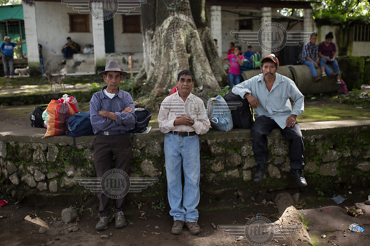 La Trinidad community elders Gervasio Lopez (left), 83, Jorge Ambrocio Garcia (centre), 63, and Ncolas Ramon Jimenez Montejo, 47, wait for army trucks to evacuate them. Originally from Huehuetenango, hundreds of families fled to Mexico in 1982 escaping state-repression during the war. In 1998, after the peace accords, the families were given land at the foot of the Fuego Volcano as part of an agreement for returning refugees. Today, La Trinidad is one of the most affected communities due to the 3 June 2018 eruption. Their community has been deemed uninhabitable and the 235 families await an uncertain future once again.