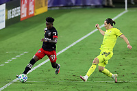 NASHVILLE, TN - SEPTEMBER 23: Oniel Fisher #91 of DC United is chased by Alex Muyl #29 of Nashville SC during a game between D.C. United and Nashville SC at Nissan Stadium on September 23, 2020 in Nashville, Tennessee.