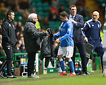 Celtic v St Johnstone.....04.03.15<br /> Danny Swanson gets a pat on the back from manager Tommy Wright as he is subbed<br /> Picture by Graeme Hart.<br /> Copyright Perthshire Picture Agency<br /> Tel: 01738 623350  Mobile: 07990 594431