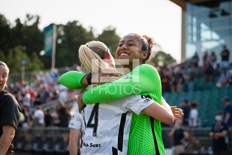 CARY, NC - SEPTEMBER 12: Tyler Lussi #34 and Abby Smith #35 of the Portland Thorns hug after a game between Portland Thorns FC and North Carolina Courage at WakeMed Soccer Park on September 12, 2021 in Cary, North Carolina.