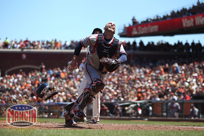 SAN FRANCISCO, CA - MAY 12:  Brian McCann #16 of the Atlanta Braves chases a foul ball during the game against the San Francisco Giants at AT&T Park on Sunday, May 12, 2013 in San Francisco, California. Photo by Brad Mangin