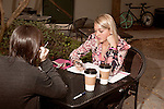 November 27, 2012. Charleston, South Carolina..Alexa Wyatt, right, meets with another wedding planner at Kudu, a downtown coffee shop. . Alexa Wyatt, 23, is an Event Coordinator with Southern Protocol, a boutique wedding and event planning company in Charleston, SC..