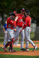 Canada Junior National Team pitching coach Jeff Francis (46) talks with pitcher Connor O'Halloran (13) and catcher Connor Caskenette (34) during an exhibition game against the Toronto Blue Jays on March 8, 2020 at Baseball City in St. Petersburg, Florida.  (Mike Janes/Four Seam Images)