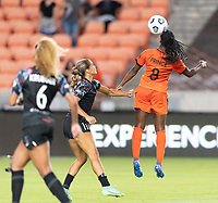 HOUSTON, TEXAS - SEPTEMBER 10: Nichelle Prince #8 of the Houston Dash heads the ball over Sarah Gorden #11 of the Chicago Red Stars during a game between Chicago Red Stars and Houston Dash at BBVA Stadium on September 10, 2021 in Houston, Texas.