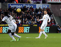 Pictured: Gylfi Sugurdsson of Swansea (R) passing the ball to team mate Bafetimbi Gomis (L) Saturday 10 January 2015<br /> Re: Barclays Premier League, Swansea City FC v West Ham United at the Liberty Stadium, south Wales, UK