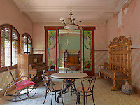 The salon and music room on the top floor is the only room, which is furnished with pieces not original to the house