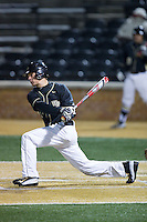 Bruce Steel (17) of the Wake Forest Demon Deacons follows through on his swing against the Delaware Blue Hens at Wake Forest Baseball Park on February 13, 2015 in Winston-Salem, North Carolina.  The Demon Deacons defeated the Blue Hens 3-2.  (Brian Westerholt/Four Seam Images)