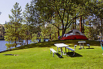 Curlew Lake, NE of Spokane, Washington has a wonderful state park for both tent and RV campers.  The water is warm in summer and fishing generally good.