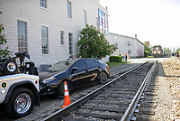 A car is shown, Monday, May 3, 2021 near the train tracks on Walnut Street and South Arkansas Street in Rogers. Rogers Police received a call at 9:29 am on Monday for a single car collision with a train. One person was admitted to the hospital, but his condition is unknown. Check out nwaonline.com/210504Daily/ for today's photo gallery. <br /> (NWA Democrat-Gazette/Charlie Kaijo)