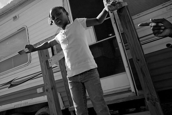 February 02, 2008. Baker, LA.. Renaissance Village trailer park for Louisiana residents displaced by Hurricanes Katrina and Rita. Over 2 years after the storms, hundreds of residents still live in the temporary trailer park, as they search for ways to move out and reestablish their lives.. Adrian Love, 9. Adrian left the park for 2 weeks for a camp in New Jersey set up by a charity, but is now back at Baker with her father, Alton, who works in Baker but is unable to get the money together to move back to New Orleans.