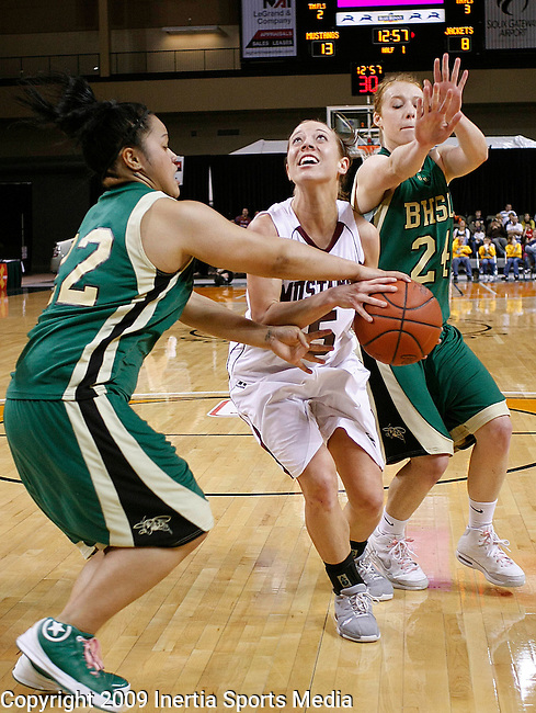 SIOUX CITY, IA - MARCH 14, 2009 --  Kayla Weerheim #5 of Morningside drives between Piggy Pili #22 and Katelynn Lamb #24 of Black Hills State during their 2009 NAIA DII Women's Basketball National Championship quarterfinal game Saturday at the Tyson Events Center in Sioux City. (Photo by Dick Carlson/Inertia)