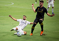 CARSON, CA - SEPTEMBER 06: Sebastian Lletget #17 of Los Angeles Galaxy battles Tristan Blackmon #27 of LAFC for a loose ball during a game between Los Angeles FC and Los Angeles Galaxy at Dignity Health Sports Park on September 06, 2020 in Carson, California.