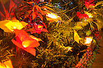 """Illuminated """"flowers"""" made from buri decorate the front garden of a home competing in Sampaloc's Bulihan Fiesta home decorating contest. (Sampaloc, Quezon Province, the Philippines)"""