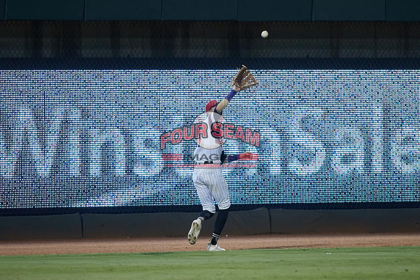 Winston-Salem Rayados left fielder Duke Ellis (11) catches a fly ball during the game against the Llamas de Hickory at Truist Stadium on July 6, 2021 in Winston-Salem, North Carolina. (Brian Westerholt/Four Seam Images)