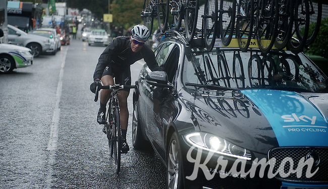 Iljo Keisse (BEL) getting a lift<br /> <br /> Tour of Britain<br /> stage 2: Carlisle to Kendal (187km)