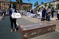 The President of the Order of lawyers of Rome during the demonstration of the lawyers in front of the Court of Cassation to ask for the reopening of the Law Courts. The protesters show signs with the inscription Justice is extinguished and a coffin with the scales of justice on it. Rome (Italy), June 23rd 2020<br /> Samantha Zucchi Insidefoto