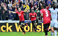 Robin Van Persie celebrating his second goal of the game.<br />