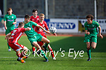 Cianan Cooney of Kerry clears his defence as Corks Alex Healy Byrne bares down on him in the U17 EA Sports soccer League