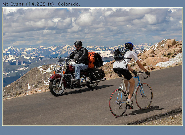 Though the Mt Evans Highwaw is paved, it's still a bit scary is spots.<br /> Motorcyclist and road biker, Mount Evans Road, Idaho Springs, Colorado. Private photo tours of Mt Evans.