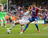 Pictured: Joel Ward of Crystal Palace (R) against Jefferson Montero of Swansea (L)<br /> Re: Premier League match between Crystal Palace and Swansea City at Selhurst Park on Sunday 24 May 2015 in London, England, UK